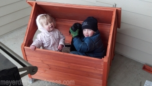 The kids helped build her dog house, and decided they liked it in there too!